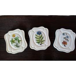 Tris di piattini decorativi in ceramica